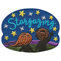 A boy and a girl stand on a grassy hill and look up at the starry sky. The text 'Stargazing' is embroidered amongst the stars.