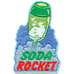 A green soda bottle filled with water is being propelled up as gas quickly pushes the water out. The water bubble mixture at the bottom of the crest has the words Soda Rocket.