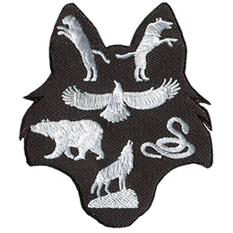 This patch is shaped like a wolf head. A panther and wolf are in the ears, a kite bird, bear, and snake rest in the middle, and a wolf on a rock sits in the snout.