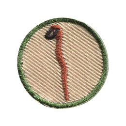 This 1 inch round patch displays an upright, crooked walking stick with a leather loop strap attached the top.