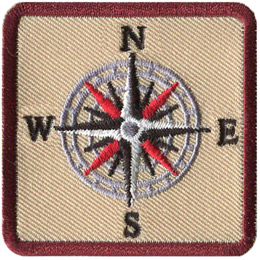 This square patch displays a sixteen point compass rose showcasing the four cardinal directions, the four intercardinal directions and the four intermediate directions.