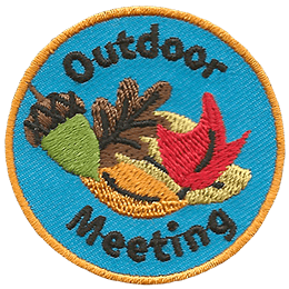 This circular crest displays a bunch of leaves in Fall colours such as brown, yellow, orange, and red. The word \'Outdoor\' arches at the top and \'Meeting\' at the bottom.