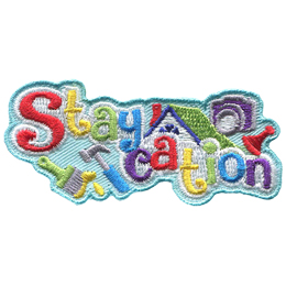 The word Staycation has each letter being a different colour; starting with the S the colours go: red, yellow, green, blue, purple, and then they repeat. A house is in the background along with a camera, a board game piece, a paint brush, and a hammer.