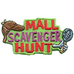 A Sherlock Holmes Hat rests on the word ''Scavenger'' in the text ''Mall Scavenger Hunt.'' A hand grasps a magnifying glass on the right side of the patch.