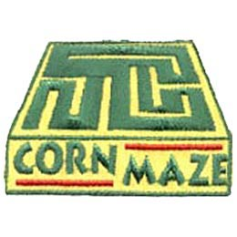 This square patch depicts a green hedge corn maze winding through a yellow box. The words ''Corn Maze'' are embroidered at the bottom of the patch.
