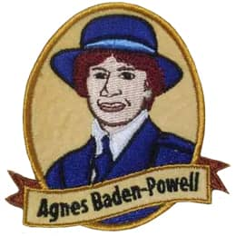 The portrait of a woman is shown inside a vertical oval with a banner that stays \'Agnes Baden-Powell\'.