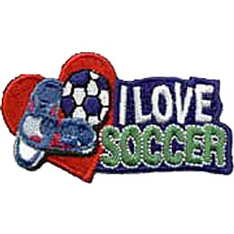 A soccer ball and cleats rests inside a big red heart. The words ''I Love Soccer'' are embroidered to the right of the heart.