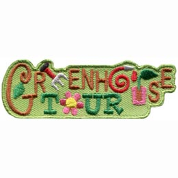 The words 'Greenhouse Tour' are written in vine like scrawl and fill the space on this embroidered patch. The first 'E' in 'green' has been replaced by a small gardening fork, the 'O' in 'house' has been turned into a watering hose, the 'U' in 'house' is a sprouting plant with two leaves, and the 'O' in 'tour' is a pink flower with a yellow center.