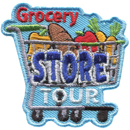 A shopping cart is loaded with food: a pepper, loaf of bread,apple, and carrots. The word 'Grocery' sits above the cart, 'Store' is written on the cart, and 'Tour' rests under the cart, but above the wheels.
