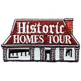 This old, red-roof house has a brick chimney and six roman styled columns to support an extended porch. The words ''Historic Homes Tour'' are embroidered on the roof.