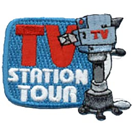 A TV shaped blue square sits in the back ground with the words TV Station Tour embroidered on it. A recording camera on its stand overlaps the right side of the blue square.