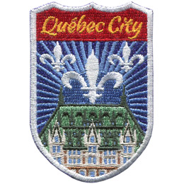 This emblem has the name \'Quebéc City\' at the top on a red background. Just below it is the blue background and white fleur-de-lys of Quebec\'s flag. Front and center is the Ville de Québec.