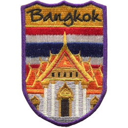 This emblem has the name \'Bangkok\' at the top on a yellow background. Just below it is the red, white, and blue striped flag of Thailand. Front and center is the Grand Palace.