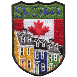 This shield shaped crest has the text St. John\'s at the top. The iconic Jellybean Row of the city is displayed with the Canada flag in the background.