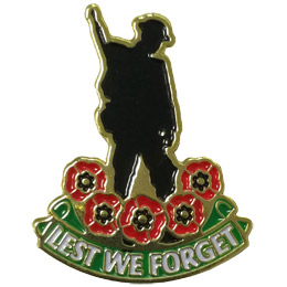<p>A silhouette of a soldier stands over a half wreath consisting of five poppies. A banner under the poppies reads \'Lest We Forget\'.</p>