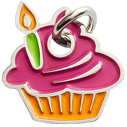 A cupcake and a single candle has been turned into a decorative metal charm.