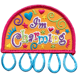 This arched patch displays the text \'I\'m Charming\' in rainbow coloured text. The background of the crest is filled with hearts, stars, and swirls. Five loops dangle from the base of this patch for which you can attach charms too.