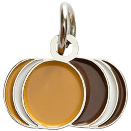 This metal charm displays both a vanilla and a chocolate cookie side by side.