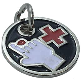 This circular metal charm depicts a red cross next to a hand with a blood drop coming out of a finger.