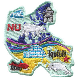 This patch is in the shape of the Canadian territory of Nunavut. From top to bottom, an ice burg, an inukshuk, a polar bear, the aurora borealis, a snowmobile and a white beluga whale are all displayed as well as a star marking the capital of Nunavut: Iqaluit.