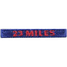 This rectangular patch says, '23 Miles' to commemorate 23 miles hiked.