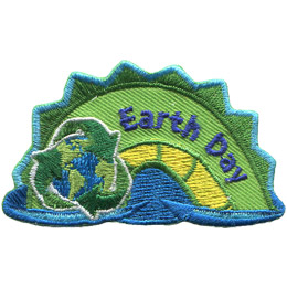 The middle hump of a sea serpent. The words \'Earth Day\' are embroidered along the middle of the hump. A globe of Earth within the three recycle arrows rests on the left most section of the hump.