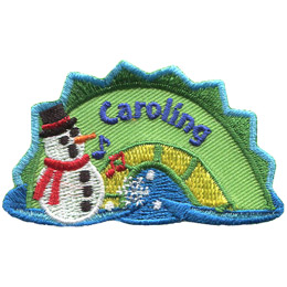 The middle hump of a sea serpent. The word \'Caroling\' is embroidered along the middle of the hump. A snowman rest on the left most section of the hump.