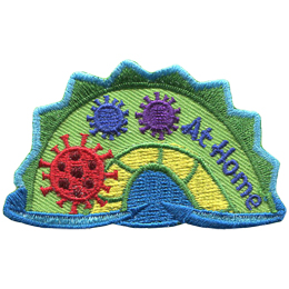 The middle hump of a sea serpent. The words 'At Home' are embroidered along the right of the hump. Three coronavirus shapes rest on the left most section of the hump.